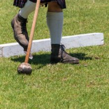 Scottish highlang games hammer throw showing the bladed boots